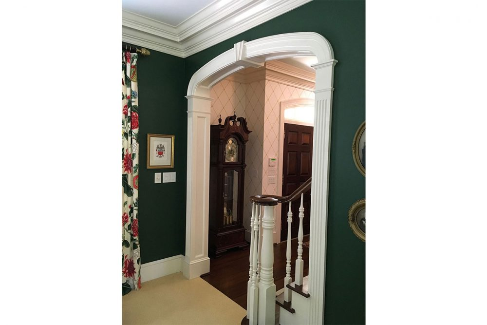 Elliptical Cased opening with Fluted Pilasters and Recess Panel Jambs